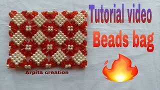A girl making new design beads bag ( পুঁতির ব্যাগ)