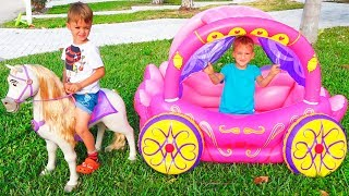 Vlad and Nikita play with Princess Carriage