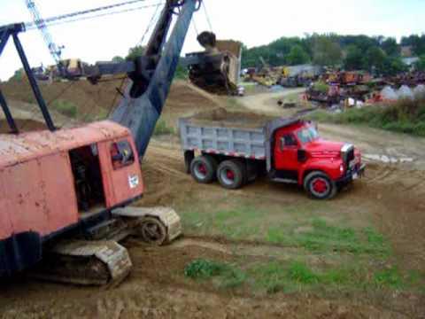 Mack B61dump truck carrying 3 loads.wmv