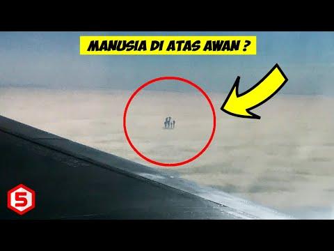 Penumpang Pesawat Geger Melihat Sosok kerumunan Manusia di atas Awan