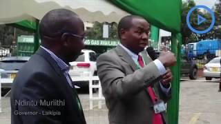 Governor Muriithi speaking during opening of Tuskys Supermarket