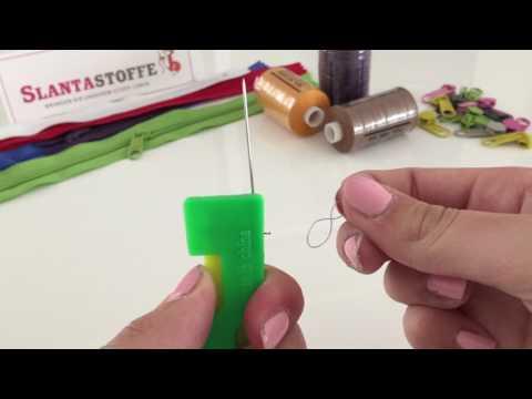 Nadeleinfädler - der Faden in Nadel einfädeln