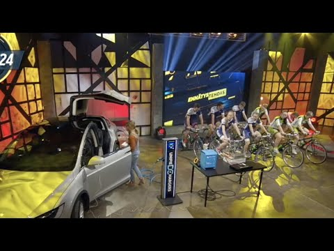9 Cyclists Try to Charge a Tesla