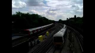 preview picture of video 'Class 165/0 no 165030 adn S8 Stock passing near Harrow on 20/06/12'