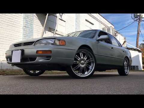 """1995 Toyota Camry sitting on 20"""" Velocity-800 Chrome wheels with 225/35-20 Lexani tires."""