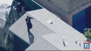 Police pursuit ends after suspect ditches vehicle, jumps on rooftops to avoid capture