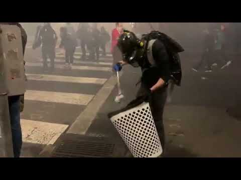 Protester Cleans In The Middle Of Police Tear Gasing