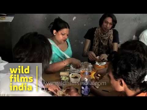 Indian transgender hijra lunches after a routine day of work