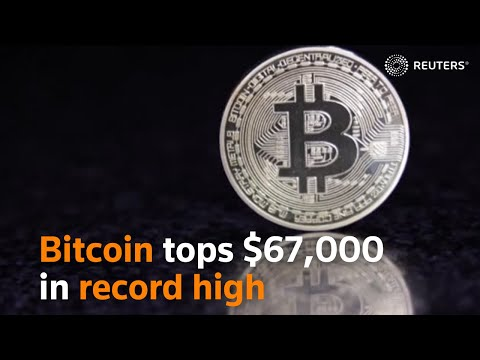 Bitcoin tops $67,000 in record high
