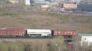 Тепловоз ЧМЕ3-???? с грузовым составом отправляется в Исакогорку