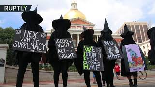 Torched Confederate flag & witch costumes: Activists protest against