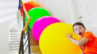 Adriana and Ali play with Colorful Balloons