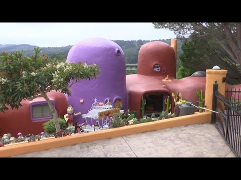 An upscale California suburb is filing suit against a homeowner who created an homage to the 1960's cartoon family, the Flintstones. Hillsborough wants retired publishing mogul Florence Fang to remove her dinosaur statues and painted mushrooms. (April 4)