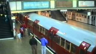 preview picture of video 'Red Tube Trains At Morden Stn'