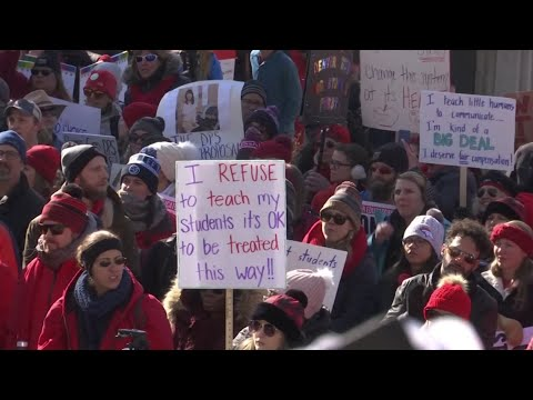 Striking teachers picketed outside of schools and marched through Denver's streets as car horns blared in support. More than 2,100 of about 4,000 teachers called in absent in Denver's first strike in 25 years. (Feb. 11)