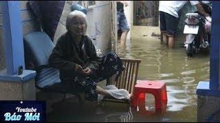 Người Sài Gòn khổ sở, kê ghế ngủ trong đêm nước ngập - Tin Tức Mới