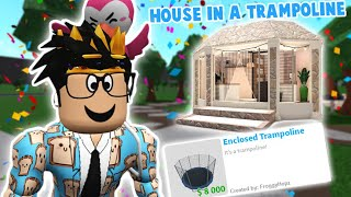 building a bloxburg house inside a TRAMPOLINE! it totally works