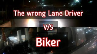 Idiot Car driver messing up with a Biker   Wrong Side
