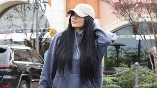 <b>Kylie Jenner</b> Does A Makeup Run In Her Yellow Ferrari