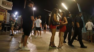 video: Magaluf residents' fury as drunk British holidaymakers 'wear no masks' and 'jump on cars'