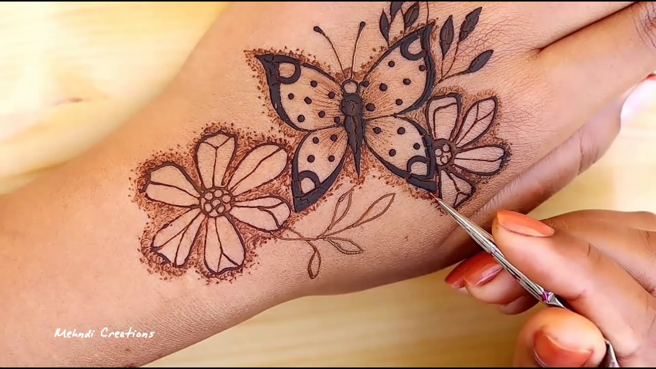 awesome butterfly mehndi design for back hand by mehndi creations
