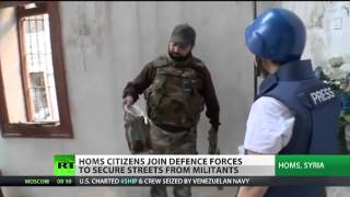 Teacher turned soldier shows reporter around war torn Homs Syria