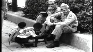 US soldiers along streets in Japan during American occupation after World War II. HD Stock Footage