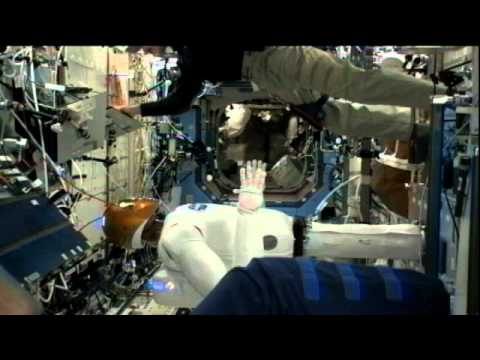 The First Astronaut-Robot Handshake In Space