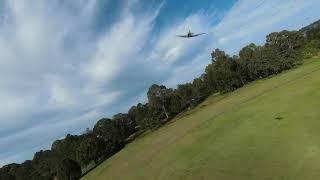 Pilot Dan flying Flying flightline Spitfire chase cam pilot Len in DJI FPV