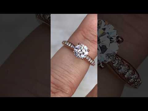"eng244c-F1 w/ ""Surprise Diamond"" prongs"