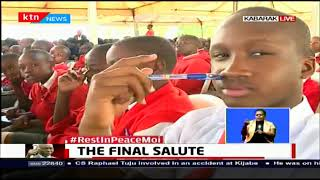 THE FINAL SALUTE: Hon. Raymond Moi leads mourners in eulogising his father
