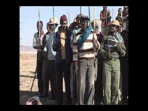 Traditional Lesotho men singing and dancing