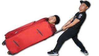 NTN - Trò Đùa Cho Người Vào Vali Kéo Đi Chơi Tết (Dragging body in the suitcase outside playing)