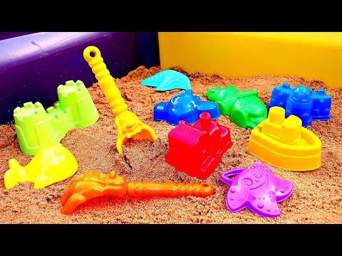 Jeux dans le bac à sable. Construisons le bac à sable coloré.