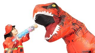 Giant Dinosaur and color balls, kids pretend play as a fire fighter