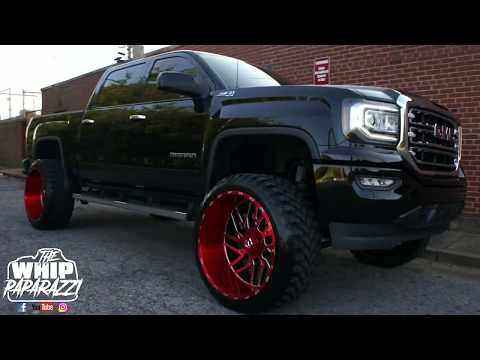 Lifted GMC Sierra Z71 on 26x14 Candy Red TIS 544 Wheels Lifted by Kc Customs