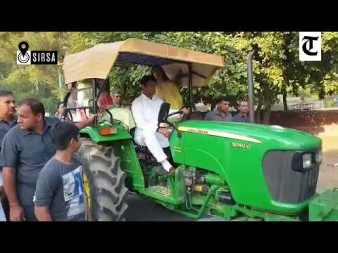 JJP leader Dushyant Chautala along with his mother rides a tractor to polling station in Sirsa