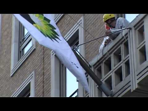 Greenpeace climbers rebrand BP with a 'british polluters' flag
