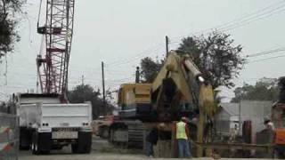 KOMATSU PC1000 digging a DEEP trench