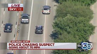 LIVE: Man at gunpoint as chase comes to an end