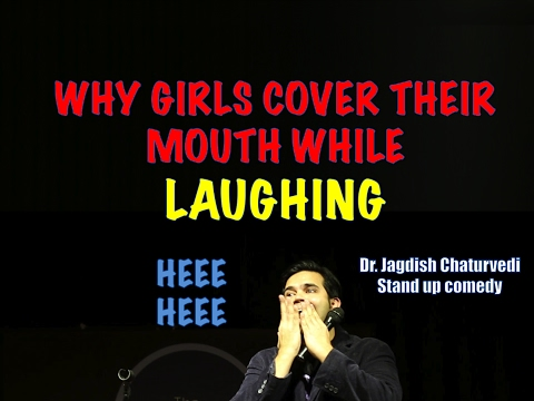 Why girls cover their mouth while laughing