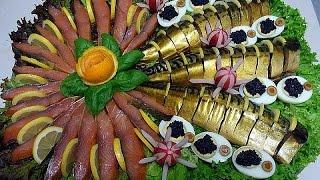 Красивая нарезка рыбы на тарелке. Праздничное оформление нарезки