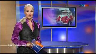 Anja Petzold In Purple Satin Blouse And Dark Dress