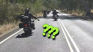 SKILLED Harley Davidson rider points at road... WHY?