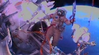 Cosmonauts take Sochi Olympic torch for first spacewalk