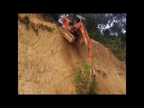 Crazy Excavator Driver Takes a Short Cut Off a Cliff