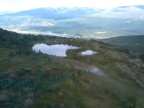 Helicopter over the Scandinavian mountai