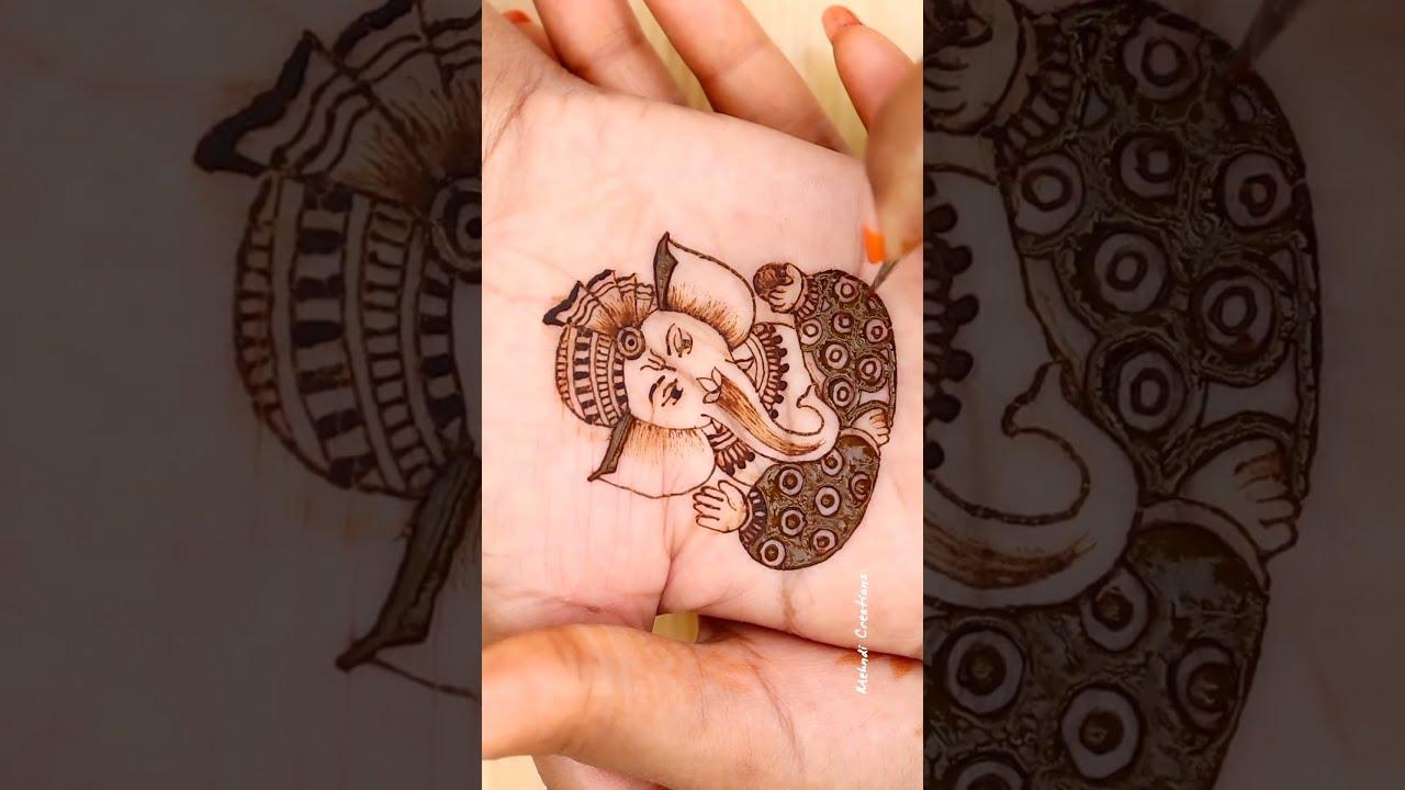 how to draw ganesha in bridal mehndi design tutorial video by mehndi creations