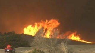 Massive wildfires tear through four states