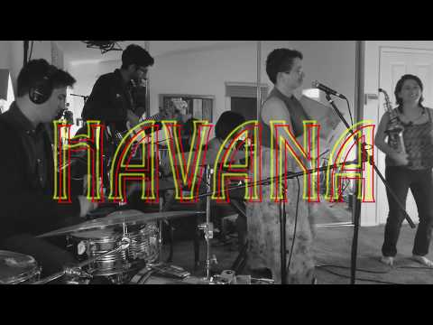 Accompanying a jazz band that covers pop tunes.